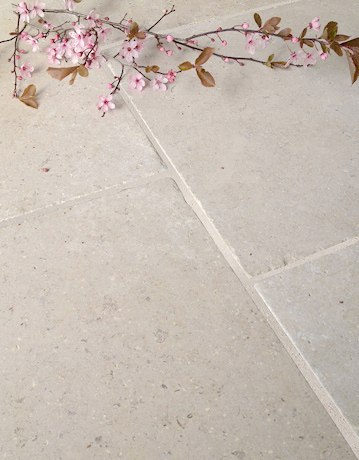 Cathedral Antique Tumbled Limestone floor tile sample.
